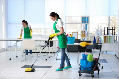 Cleaning service team working in office